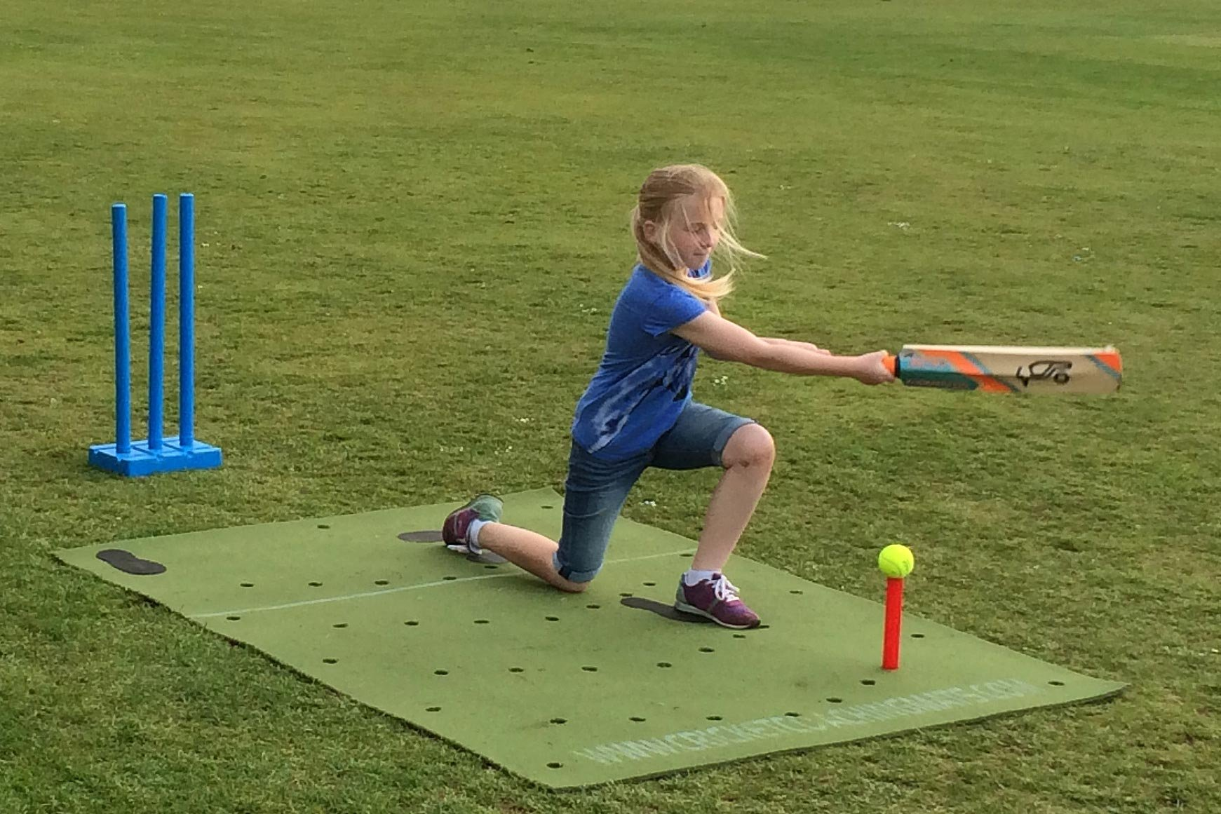 coach. Practice cricket in the garden with the cricket training, practice coaching mat